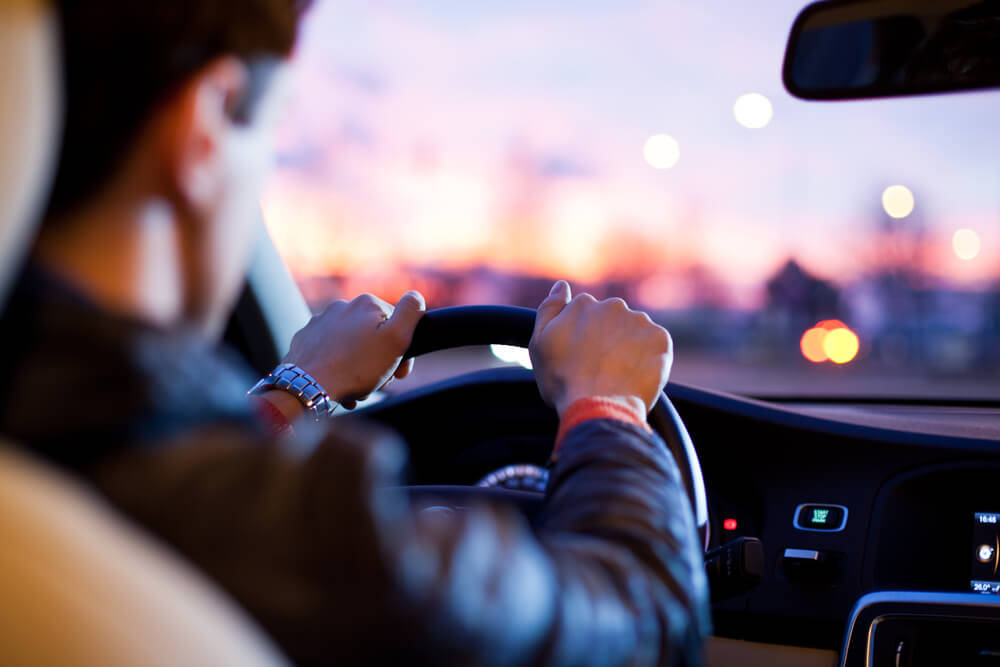 Man Driving Car In The Evening