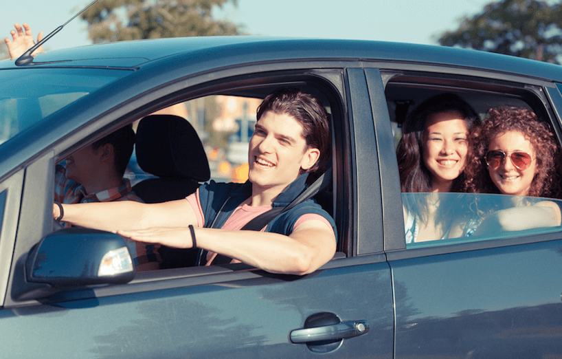 Teenager Driving A Car With Friends