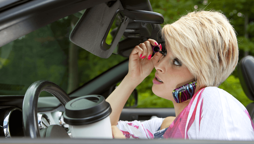 Woman Driving Distracted