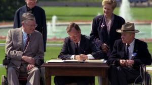Bush signs into law American Disabilities Act
